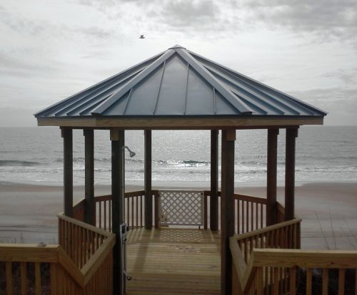 Metal roof installed on top of gazebo looking out over the ocean in carolina beach nc