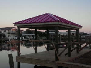 red metal roof installed on dock on intercoastal waterway in hampstead nc