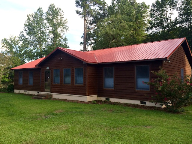red metal roof installed on home in leland nc