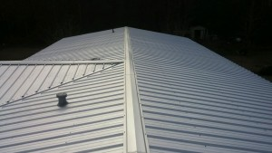 Top surface of metal roof with standing seam installed in wilmington nc